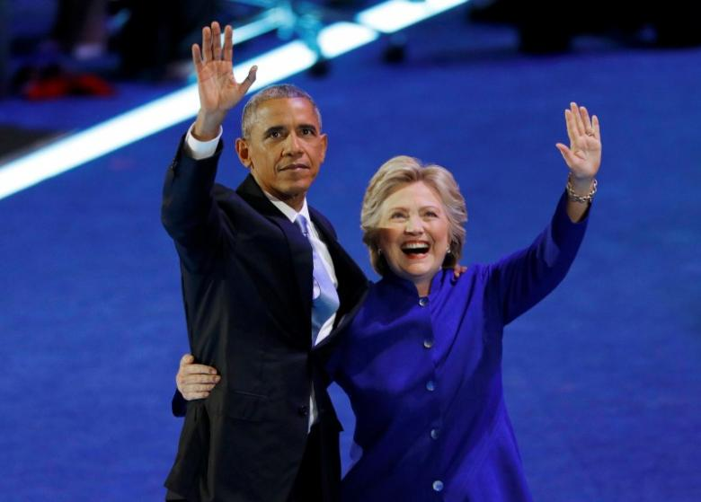 U.S. President Barack Obama is joined by Democratic Nominee for President Hillary Clinton on stage at the Democratic National Convention in Philadelphia