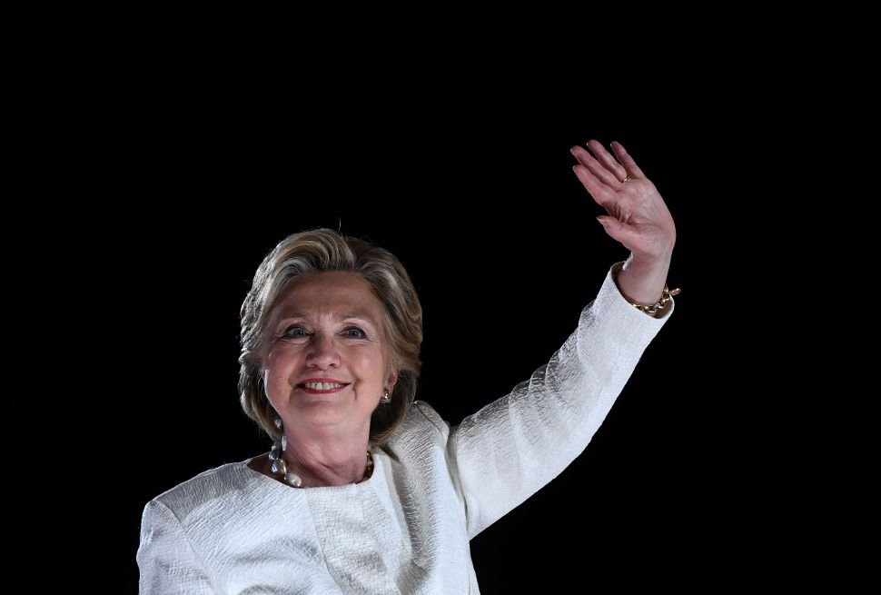 US Democratic presidential nominee Hillary Clinton waves to supporters during a  campaign rally in Sanford, Florida, on November 1, 2016.  With one week to go until election day, Hillary Clinton and Donald Trump were barnstorming battleground states, as the Democratic nominee tried to pivot away from attacks on her protection of US secrets. / AFP / JEWEL SAMAD        (Photo credit should read JEWEL SAMAD/AFP/Getty Images)