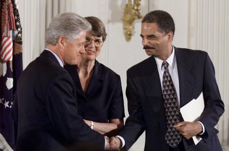 ** FILE ** In this July 20, 1999 file photo, President Clinton shakes hand with Deputy Attorney General Eric Holder, right, as Attorney General Janet Reno looks on at a American Bar Association Presidential Call to Action event at the White House in Washington. Holder is President-elect Barack Obama's top choice to be the next attorney general and aides have gone so far as to ask senators whether he would be confirmed, an Obama official and people close to the matter said Tuesday, Nov. 18, 2008. (AP Photo/Ron Edmonds, File)